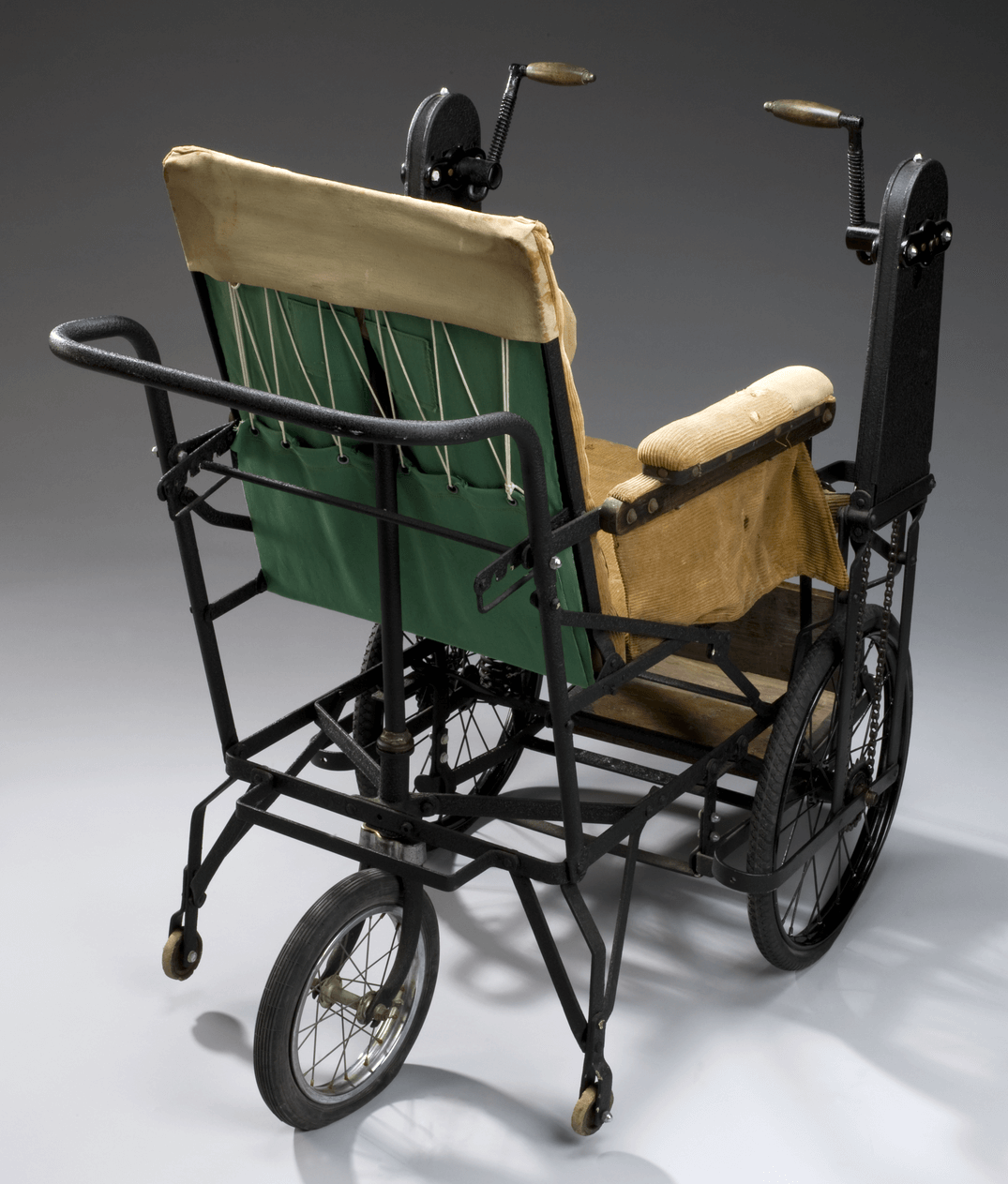 A hand-cranked wheelchair build between 1920-20