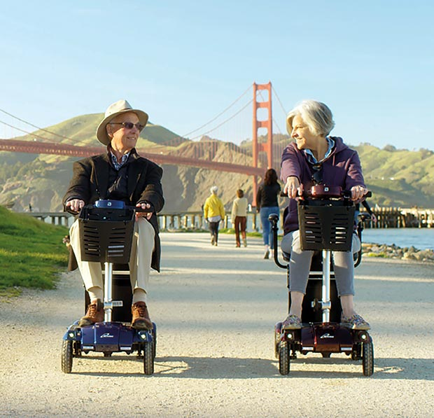 Couple enjoying their i3 mobility scooters